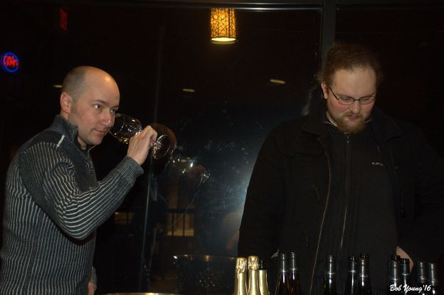 Keith Nyquist and Adrien serve and explain the wines.