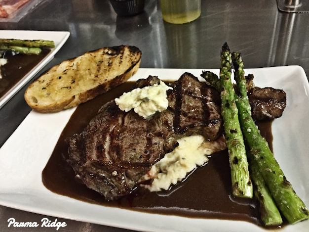 One-Inch Cut Char-Grilled Ribeye Steak with Bleu Cheese Butter, Rosemary Truffle Mashed Potatoes with Cabernet Beef Demi-Glace, Grilled Asparagus and Storm's Homemade Grilled Bread for $14.95, while supplies last